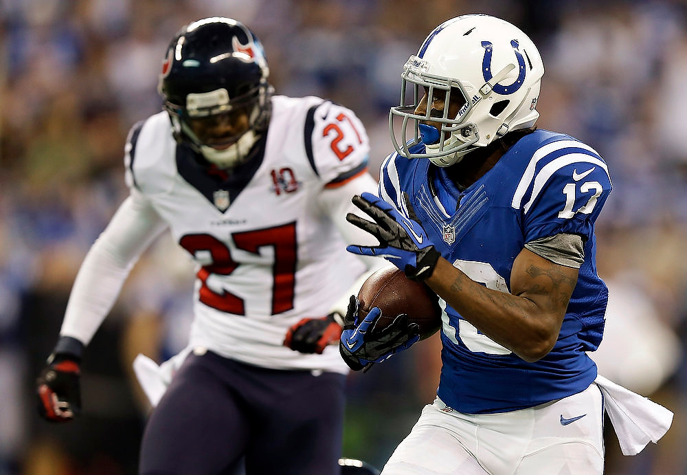 Description of . Indianapolis Colts' T.Y. Hilton (13) makes a 70-yard touchdown reception against Houston Texans' Quintin Demps (27) during the second half of an NFL football game, Sunday, Dec. 30, 2012, in Indianapolis. (AP Photo/Michael Conroy)