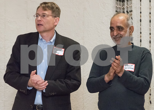 03/15/18 Wesley Bunnell | Staff Former Democractic candidate for Mayor of New Britain Merrill Gay stands alongside Malik Naveed bin Rehman at the Pulaski Club on Thursday evening as after Democratic candidates for state office met with the Democratic Town Committee and New Britain residents. Rahman who owns Pizza Corner in New Britain is facing deportation to his native Pakistan.