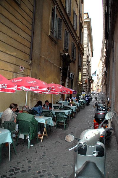 Bernd thought it was funny to be eating in an alleyway, but this is very typical of the outdoor eating areas in Italy.