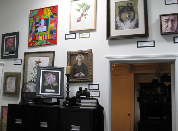 paintings hung salon style