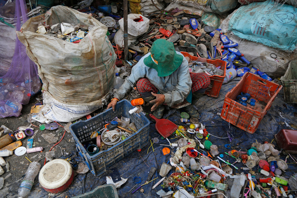 ". A rag picker segregates plastic waste for recycling at a junkyard in Kathmandu, Nepal, Monday, June 4, 2018. The theme for this year\'s World Environment Day, marked on June 5, is ""Beat Plastic Pollution.\"" (AP Photo/Niranjan Shrestha)"