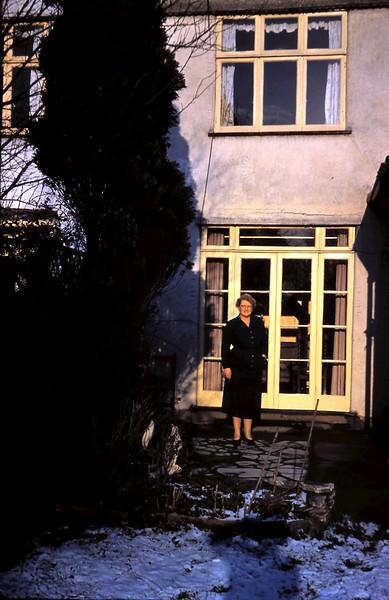 1960-1-10 (17) Mrs Nesbit @ her back door, Kent.JPG