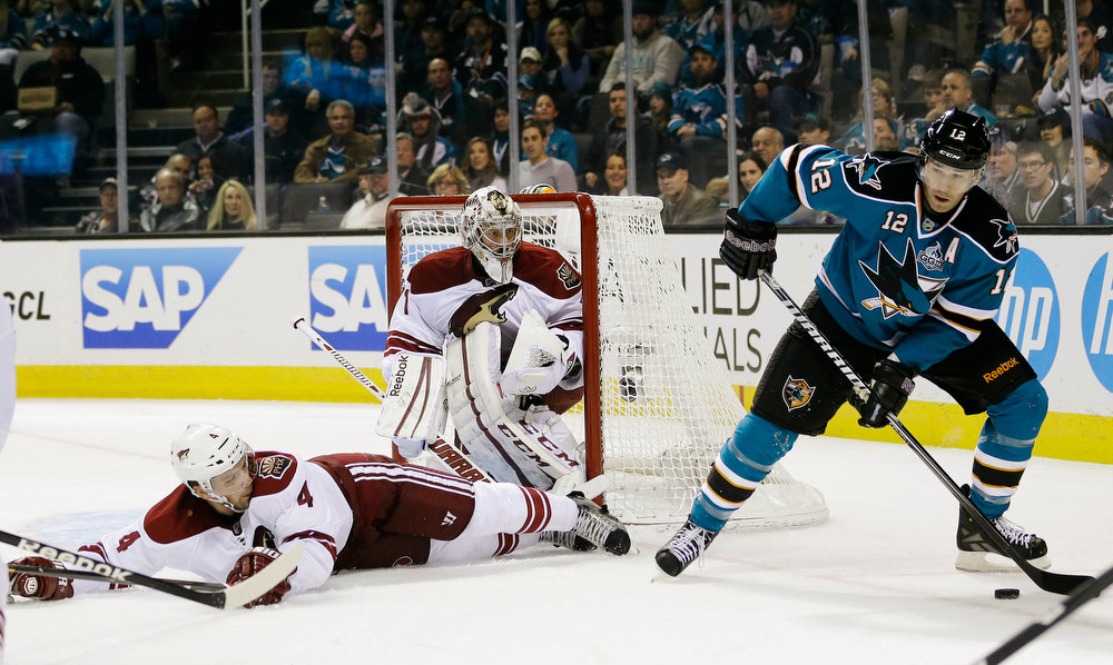 Description of . Phoenix Coyotes defenseman Zbynek Michalek, of the Czech Republic, left, lays down to block a shot attempt by San Jose Sharks center Patrick Marleau (12) as goalie Jason LaBarbera watches during the first period of an NHL hockey game in San Jose, Calif., Thursday, Jan. 24, 2013. (AP Photo/Marcio Jose Sanchez)