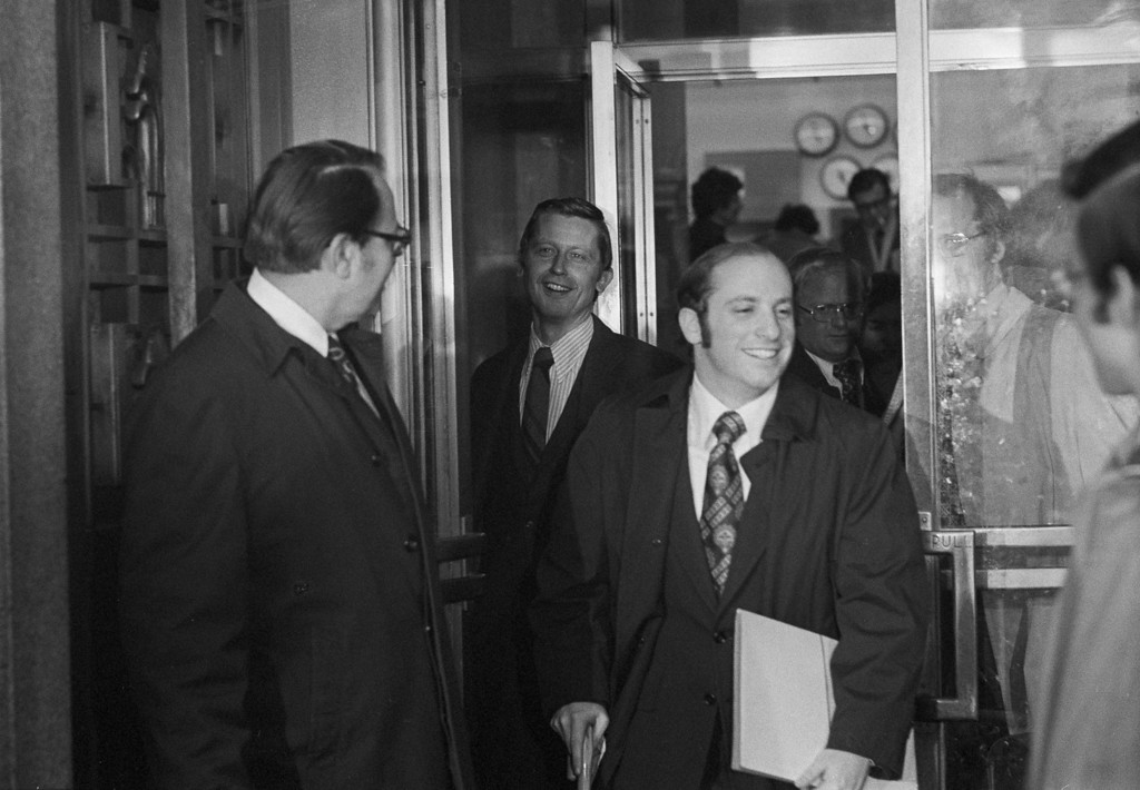 . Herbert Miller, left, attorney for former President Richard M. Nixon, holds the door open for Special Watergate prosecutor Henry Ruth as they leave the U.S. Court of Appeals in Washington, Feb. 1, 1975.  Miller asked the court to stay a lower court\'s ruling on ownership of presidential papers.  (AP Photo/Charles Harrity)