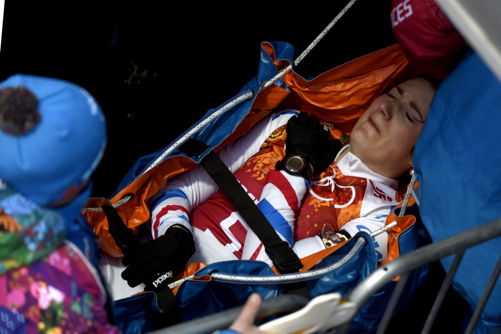 . France\'s Marie Laure Brunet is stretchered away at the start of the Women\'s Biathlon 4x6 km Relay at the Laura Cross-Country Ski and Biathlon Center during the Sochi Winter Olympics on February 21, 2014, in Rosa Khutor, near Sochi.  (ODD ANDERSEN/AFP/Getty Images)