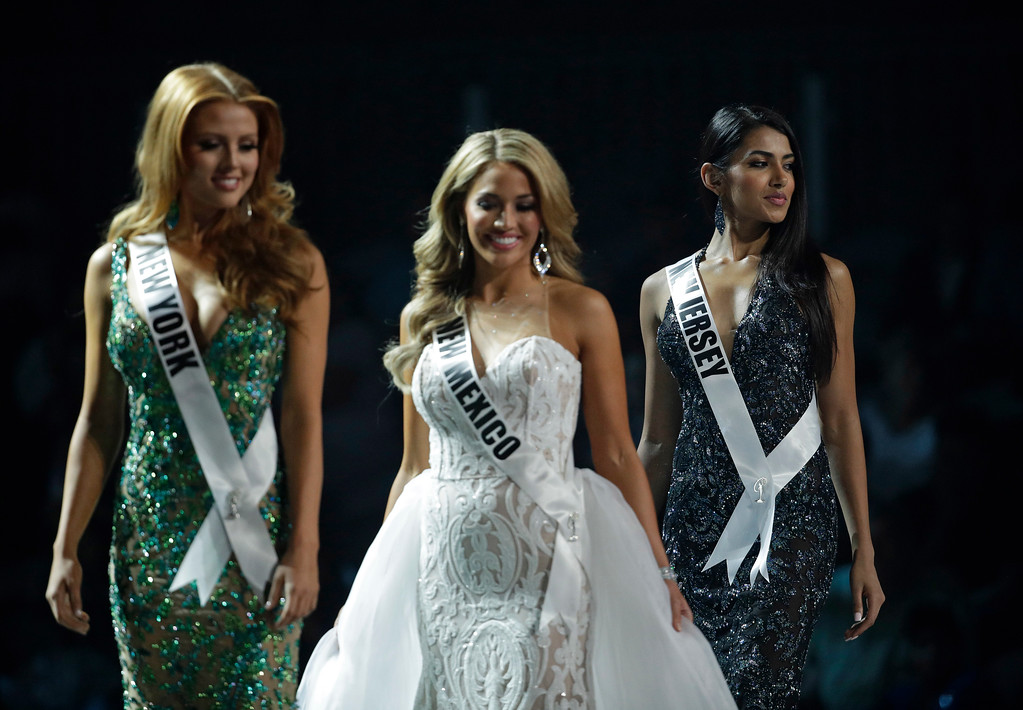 . CORRECTS NAME VERG ON SECOND REFERENCE In this May 11, 2017, photo, Miss New Jersey USA Chhavi Verg, right, competes during a preliminary competition for Miss USA in Las Vegas. Verg emigrated from India with her parents. Five of the contestants vying for the Miss USA title this year were born in other countries and now U.S. citizens. (AP Photo/John Locher)