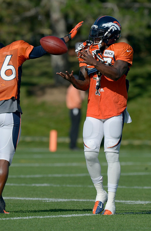 . Denver Broncos SS Duke Ihenacho (33) warms up before practice during training camp August 6, 2013 at Dove Valley. (Photo By John Leyba/The Denver Post)