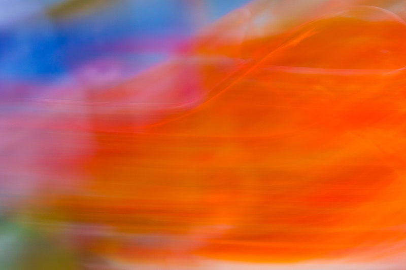 Orange and red waves of glass dance across an abstract image