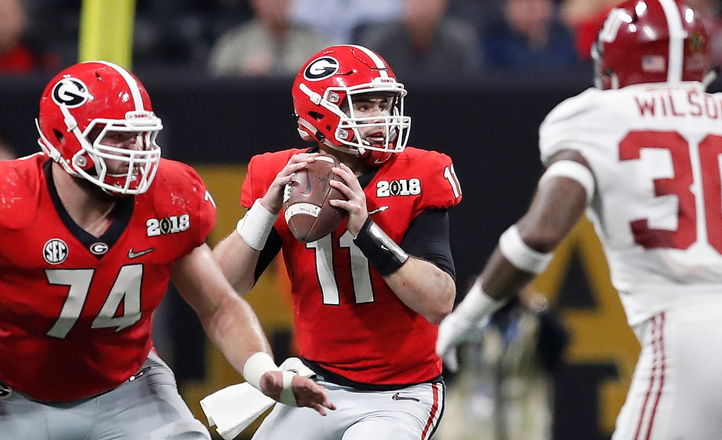 . Georgia quarterback Jake Fromm throws during the first half of the NCAA college football playoff championship game against Alabama Monday, Jan. 8, 2018, in Atlanta. (AP Photo/David Goldman)