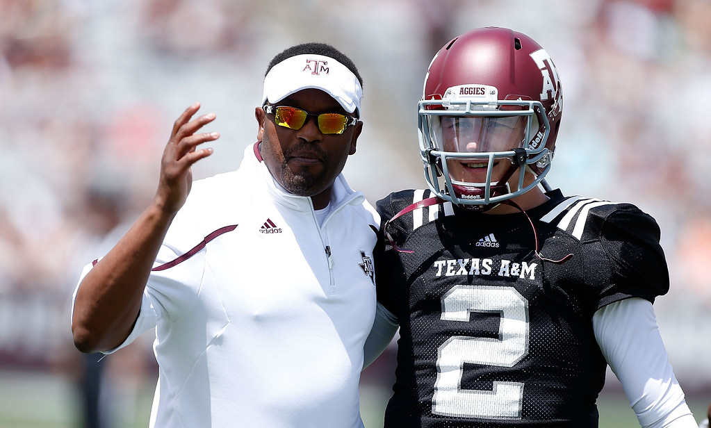 . Head coach Kevin Sumlin of the Texas A&M Aggies chats with his quarterback Johnny Manziel #2 before the Maroon & White spring football game at Kyle Field on April 13, 2013 in College Station, Texas.  (Photo by Scott Halleran/Getty Images)