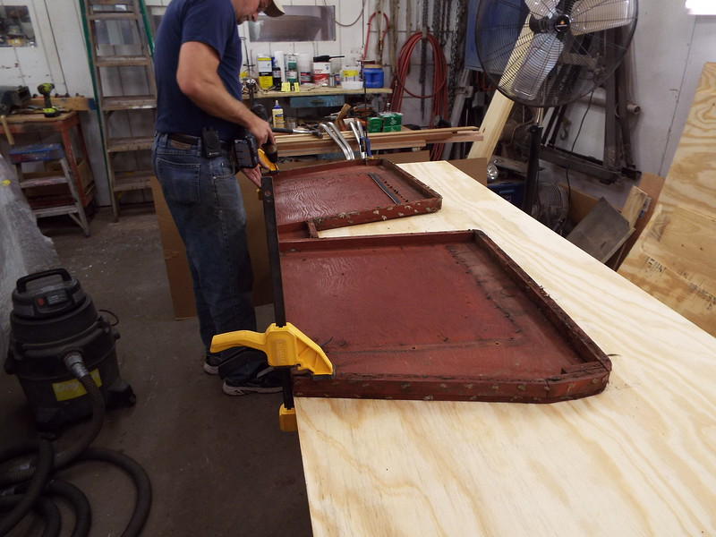 Laying out the old front seat bottom on new plywood.