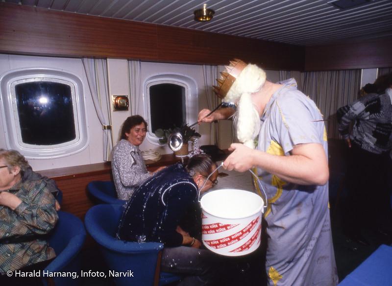 """""""Kong Neptun"""" i dåpsseremoni ombord på Nordnorge i det vi passerer polarsirkelen."""