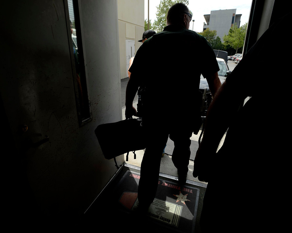. San Bernardino Police SMASH Unit officer Ray Bonshire leaves the SBPD headquarters to participate in a sweep of downtown San Bernardino April 4, 2013. GABRIEL LUIS ACOSTA/STAFF PHOTOGRAPHER.
