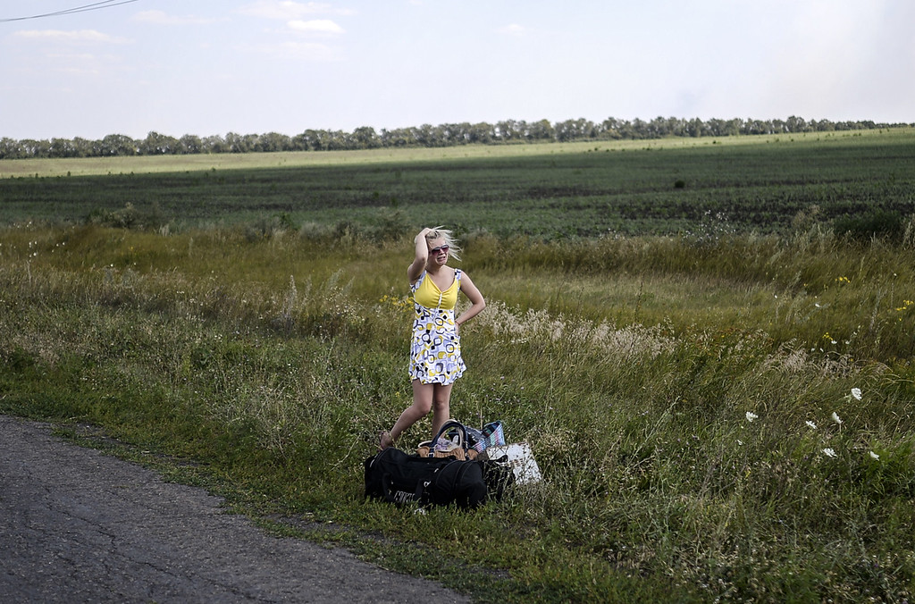 . An Ukrainian girl cries as she stands on the road with her luggage after she left her home near the village of Hrabove (Grabovo), some 80km east of Donetsk on August 2, 2014. The insurgent stronghold of Lugansk in eastern Ukraine is on the verge a humanitarian catastrophe, the mayor warned Saturday, as a siege by government troops has seen water, electricity and food supplies cut off.   AFP PHOTO/ BULENT KILIC/AFP/Getty Images