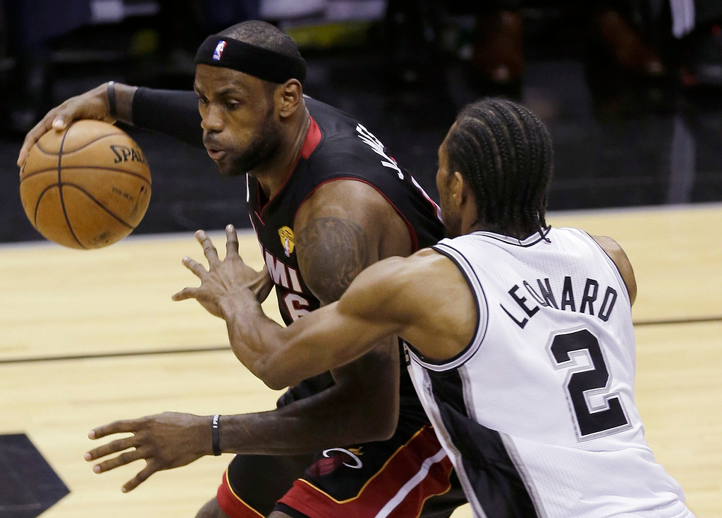 . Miami Heat\'s LeBron James (6) is defended by San Antonio Spurs\' Kawhi Leonard (2) during the first half at Game 4 of the NBA Finals basketball series, Thursday, June 13, 2013, in San Antonio. (AP Photo/David J. Phillip)