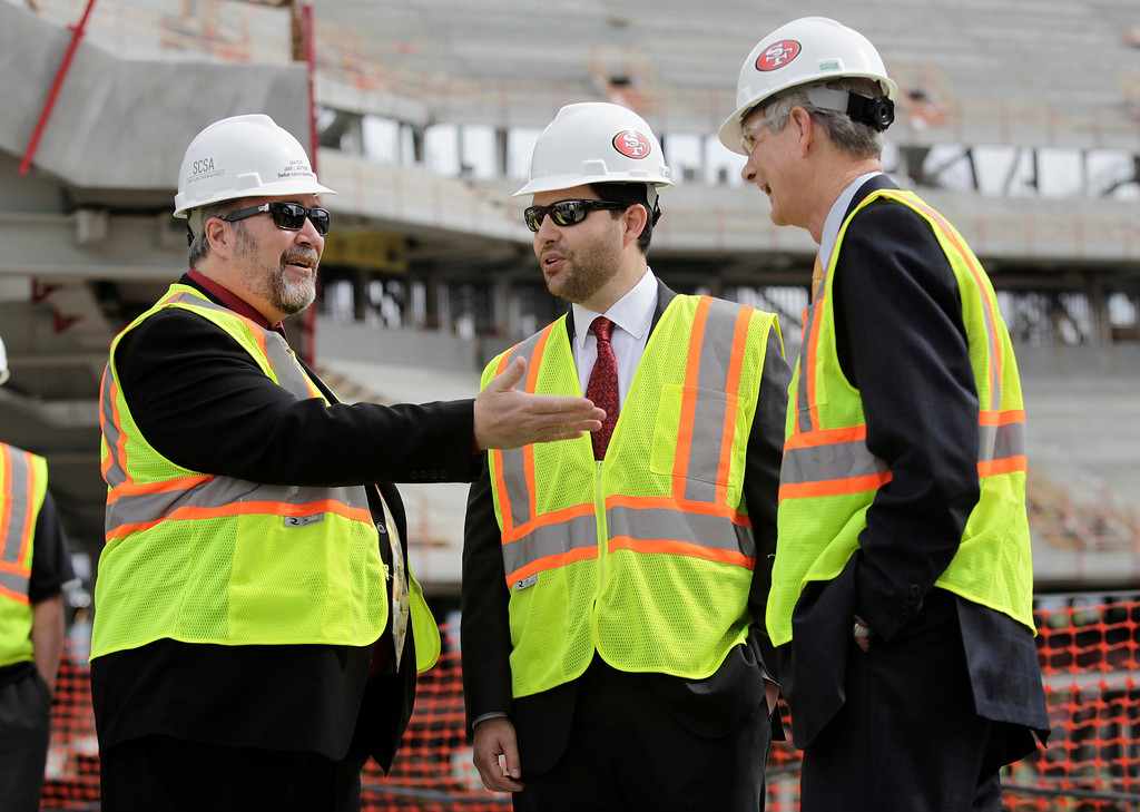. From left: Santa Clara Mayor Jamie Matthews chats with Jed York, 49ers CEO, and San Jose Mayor Chuck Reed following a press conference held by the Super Bowl Host Committee at the construction site of the new 49ers stadium in Santa Clara, Calif. on Wednesday, March 6, 2013. The Super Bowl Host Committee is competing against Miami for the bragging rights of hosting the 50th Super Bowl in 2016.  (Gary Reyes/ Staff)