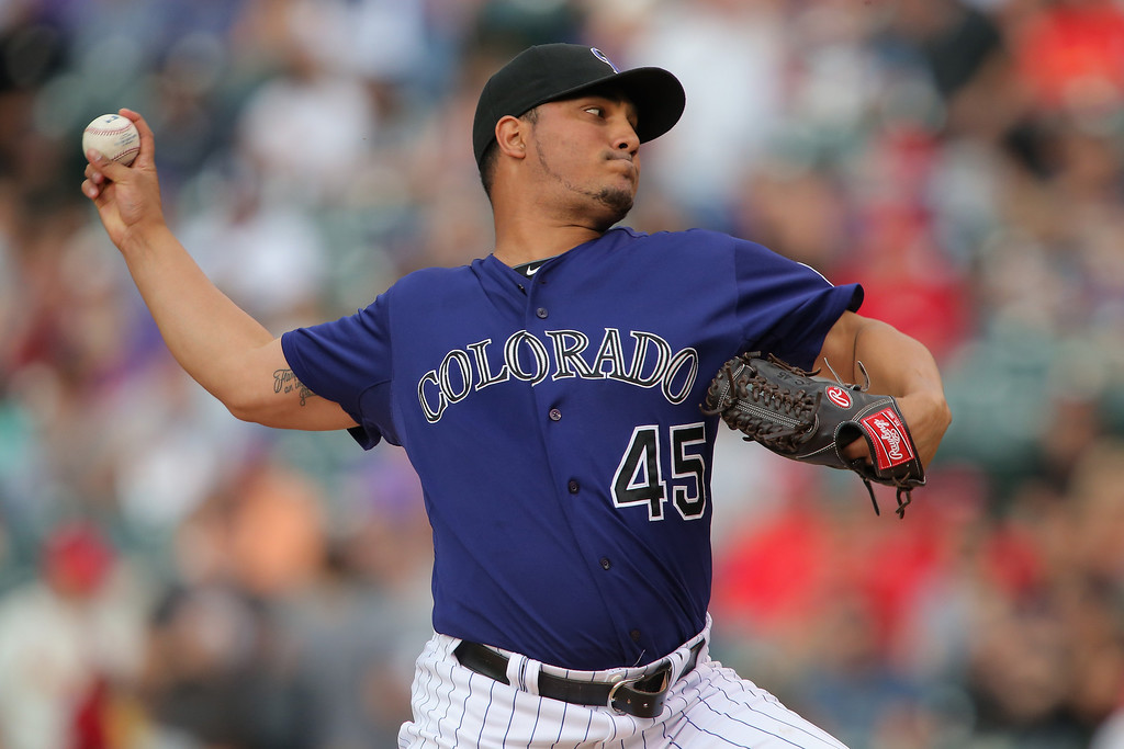 . Starting pitcher Jhoulys Chacin #45 of the Colorado Rockies delivers against the St. Louis Cardinals at Coors Field on June 23, 2014 in Denver, Colorado.  (Photo by Doug Pensinger/Getty Images)