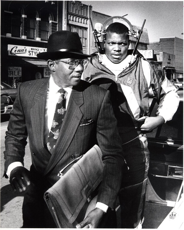 . FILE PHOTO: Dec. 5, 1989.  Attorney Elbert Hatchett, left, and Detroit Lions player Reggie Rogers.  Rogers was found guilty in the deaths of two men in a drunk driving accident in Pontiac on October 20, 1988.   The Oakland Press/TIM THOMPSON