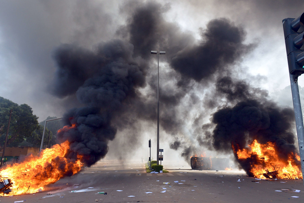 . Cars and documents burn outside the parliament in Ouagadougou on October 30, 2014.ISSOUF SANOGO/AFP/Getty Images