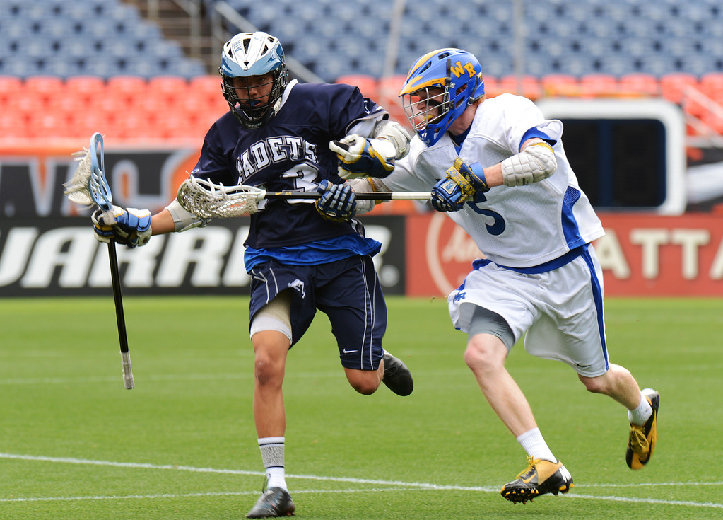 . DENVER, CO. - MAY 18 : Nick Wallen of Air Academy High School (13) controls the ball against Jacob Gladfelter of Wheat Ridge High School (5) during 4A Boy\'s Lacrosse Championship game at Sports Authority Field at Mile High Stadium. Denver, Colorado. May 18, 2013. (Photo By Hyoung Chang/The Denver Post)