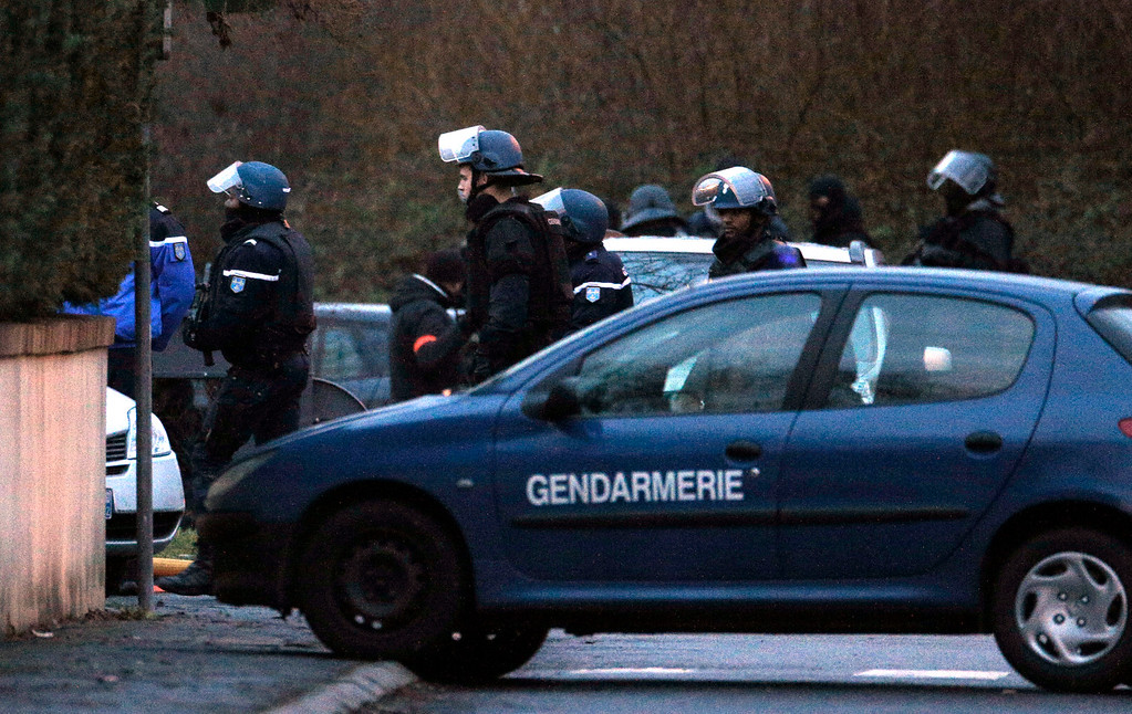 . Police officers leave after storming the building in Dammartin-en-Goele, northeast of Paris, where the two brothers suspected in a deadly terror attack were cornered, Friday, Jan. 9, 2015. A police official on the scene of the standoff between two armed brothers suspected in the massacre at the Charlie Hebdo newsroom says the suspects are dead, and their hostage has been freed. (AP Photo/Christophe Ena)