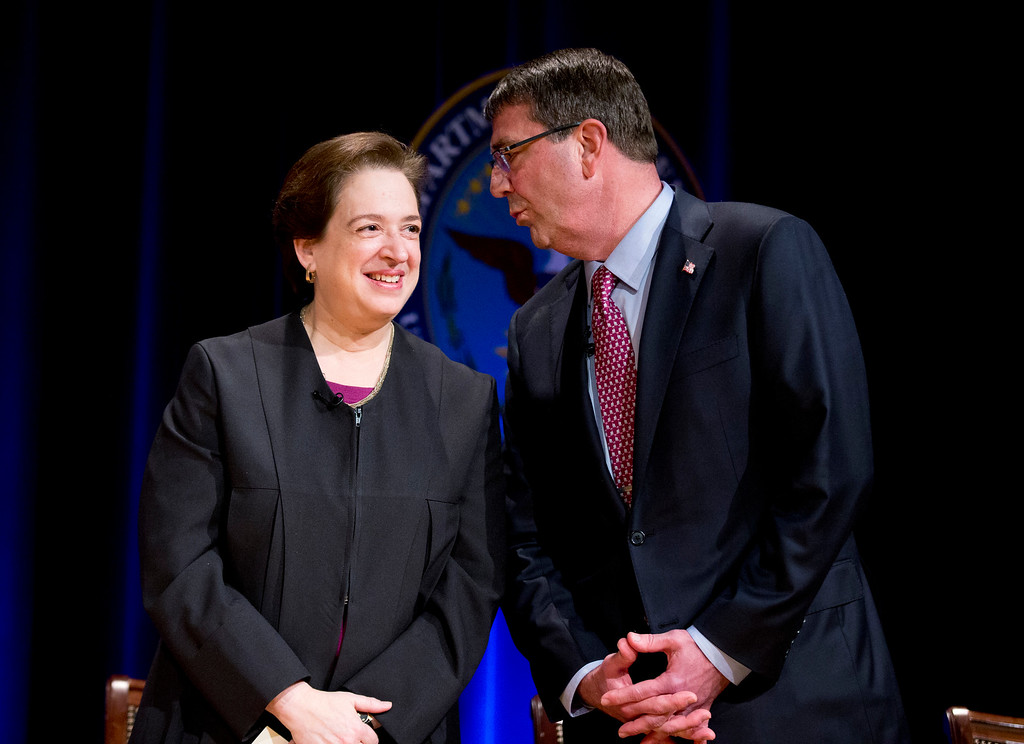 . Defense Secretary Ash Carter, right, talks to Associate Supreme Court justice Elena Kagan, left, during a ceremonial swearing-in ceremony at the Pentagon, Friday, March 6, 2015.    (AP Photo/Manuel Balce Ceneta)