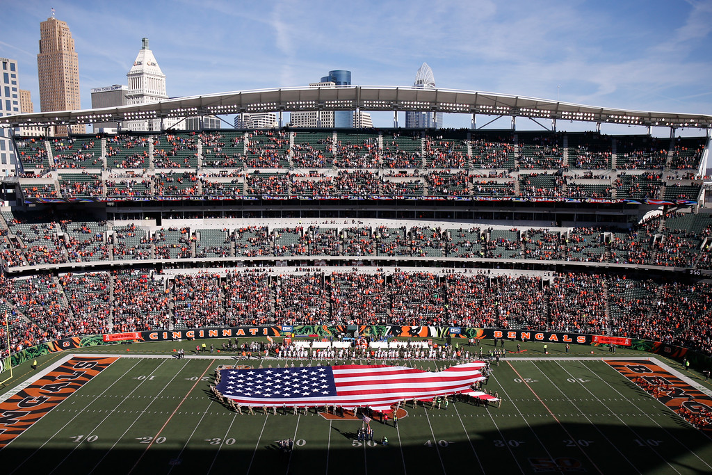 . A flag in the shape of the continental United States is unfurled on the field before an NFL football game between the Cincinnati Bengals and the Cleveland Browns, Sunday, Nov. 26, 2017, in Cincinnati. (AP Photo/Gary Landers)