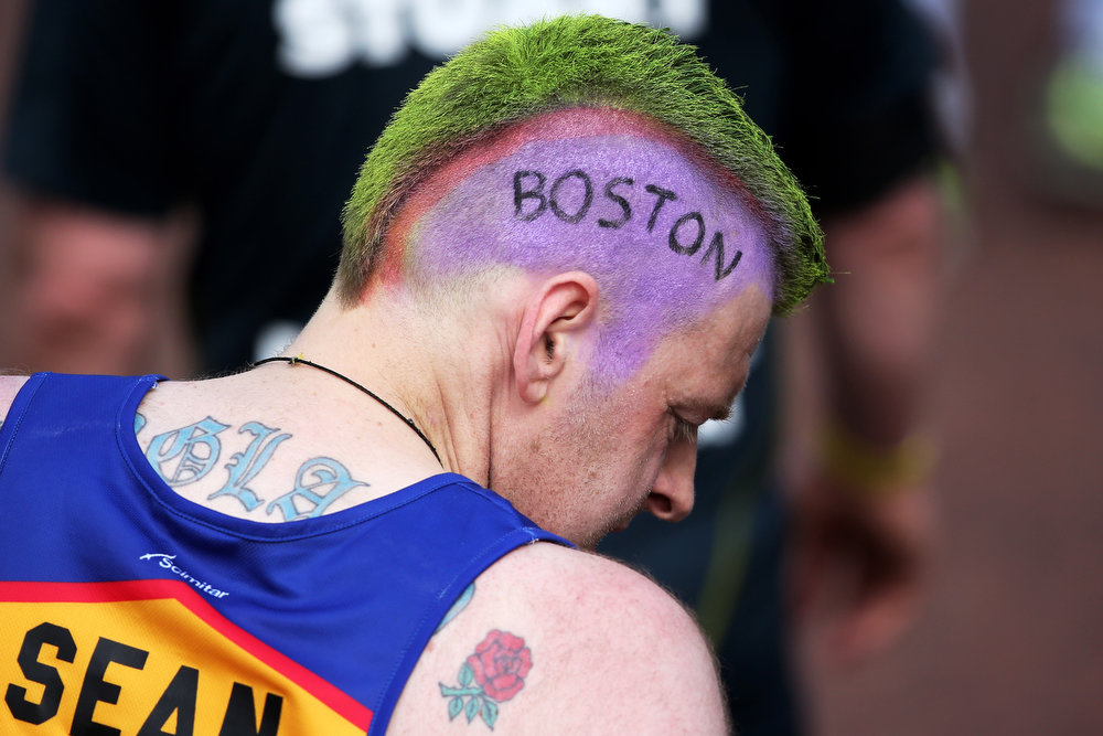 Description of . A competitor shows his sympathy towards the victims of the Boston Marathon bombing during the Virgin London Marathon 2013 on April 21, 2013 in London, England.  (Photo by Chris Jackson/Getty Images)