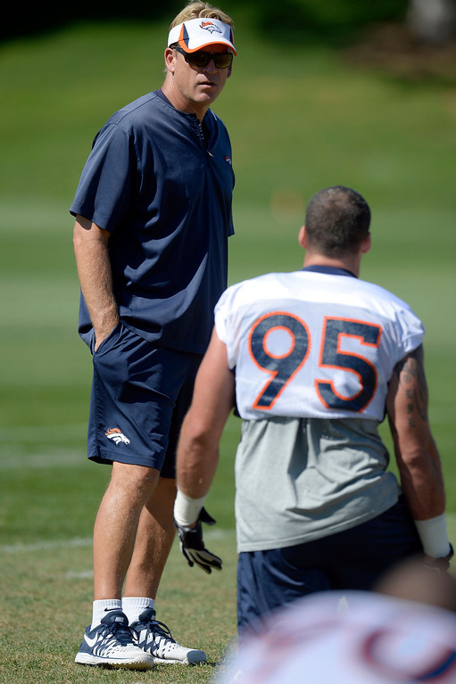 . Denver Broncos defensive coordinator Jack Del Rio talks with Denver Broncos defensive end Derek Wolfe (95) before practice September 3, 2013 at Dove Valley. (Photo by John Leyba/The Denver Post)