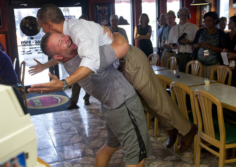 . US President Barack Obama is picked up by Scott Van Duzer, owner of Big Apple Pizza and Pasta Italian Restaurant during a visit to the restaurant in Fort Pierce, Florida, September 9, 2012, during the second day of a 2-day bus tour across Florida. AFP PHOTO / Saul LOEB/AFP/Getty Images