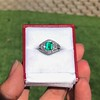 1.29ctw Emerald and Diamond Modified Halo Ring 1