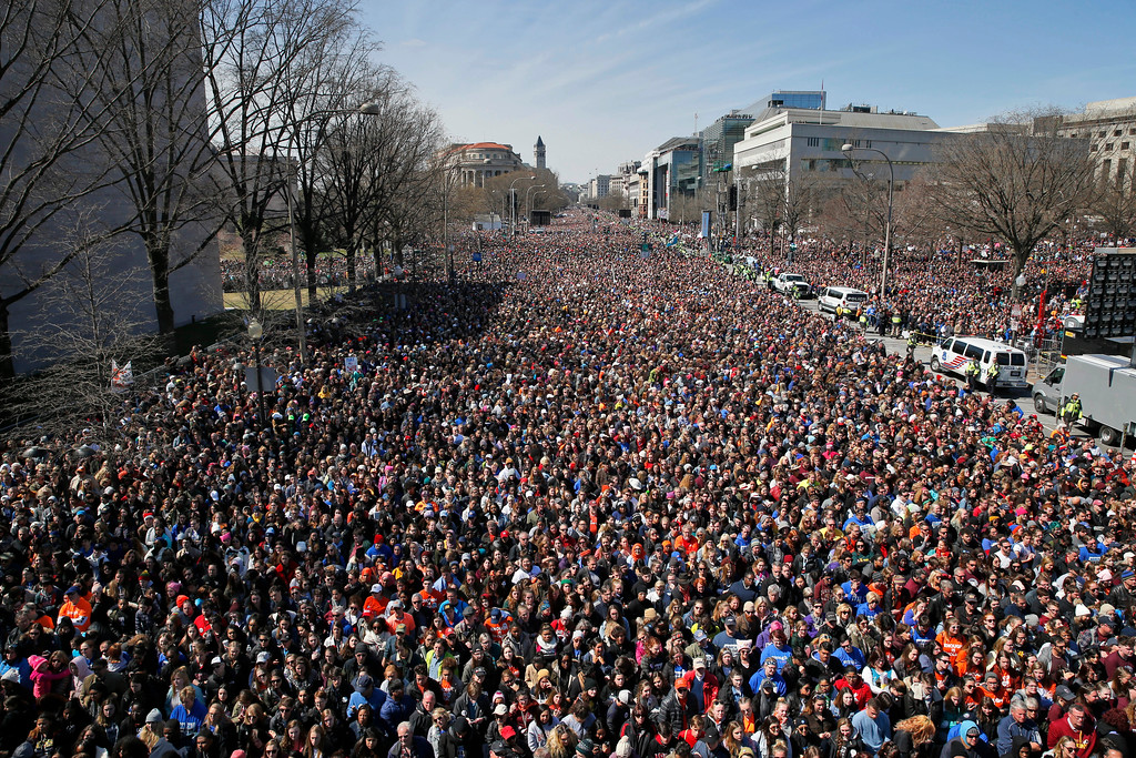 ". Looking west away from the stage, the crowd fills Pennsylvania Avenue during the ""March for Our Lives\"" rally in support of gun control, Saturday, March 24, 2018, in Washington. (AP Photo/Alex Brandon)"