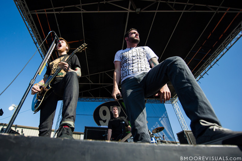 """Neil Westfall, Joshua Woodard, and Jeremy McKinnon of A Day To Remember perform in support of """"What Separates Me from You"""" on December 5, 2010 during 97X Next Big Thing at 1-800-ASK-GARY Amphitheatre in Tampa, Florida"""