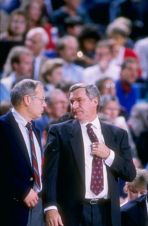 . FILE - FEBRUARY 8:  According to reports February 8, 2015, former North Carolina Tar Heels basketball coach Dean Smith has died at the age of 83. 1988:  Head coach Dean Smith, right, talks with assistant coach Bill Guthridge, left, during a North Carolina Tar Heels game. Mandatory Credit: Allen Dean Steele  /Allsport