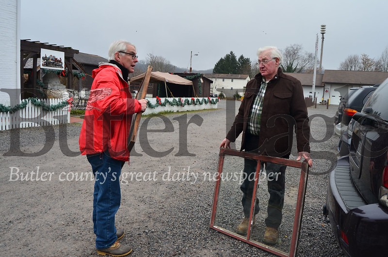 Glenn Studebaker (right) moves the old windows from his house, built sometime between the 1820s and 1830s, with Rodney Gasch (left), Historic Harmony president. The windows will be used for the restoration project at the Wagner Haus.  Pics by Alexandria Mansfield.