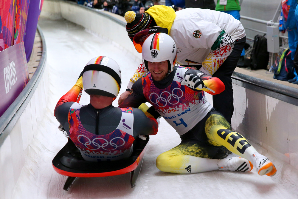 . Tobias Arlt (R) of Germany celebrates after winning the gold medal with Tobias Wendl (L) during the Men\'s Luge Doubles on Day 5 of the Sochi 2014 Winter Olympics at Sliding Center Sanki on February 12, 2014 in Sochi, Russia.  (Photo by Alex Livesey/Getty Images)
