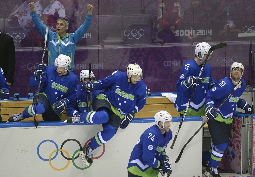 . Slovenia\'s players celebrate at the end of the Men\'s Ice Hockey Play-offs Solovenia vs Austria at the Bolshoy Ice Dome during the Sochi Winter Olympics on February 18, 2014. Slovenia won 4-0.  (ALEXANDER NEMENOV/AFP/Getty Images)
