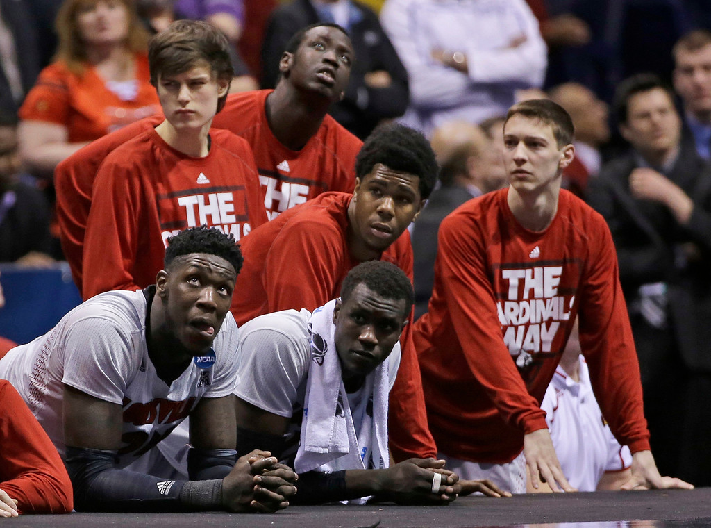 . The Louisville bench watches during the second half of an NCAA Midwest Regional semifinal college basketball tournament game against the Kentucky Saturday, March 29, 2014, in Indianapolis. (AP Photo/David J. Phillip)