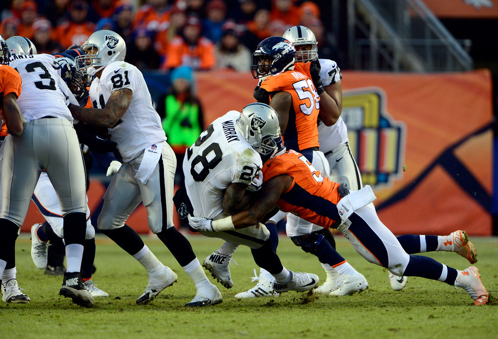 . DENVER, CO - DECEMBER 28: Latavius Murray (28) of the Oakland Raiders gains six yards in the third quarter.  The Denver Broncos played the Oakland Raiders at Sports Authority Field at Mile High in Denver on December, 28 2014. (Photo by Joe Amon/The Denver Post)