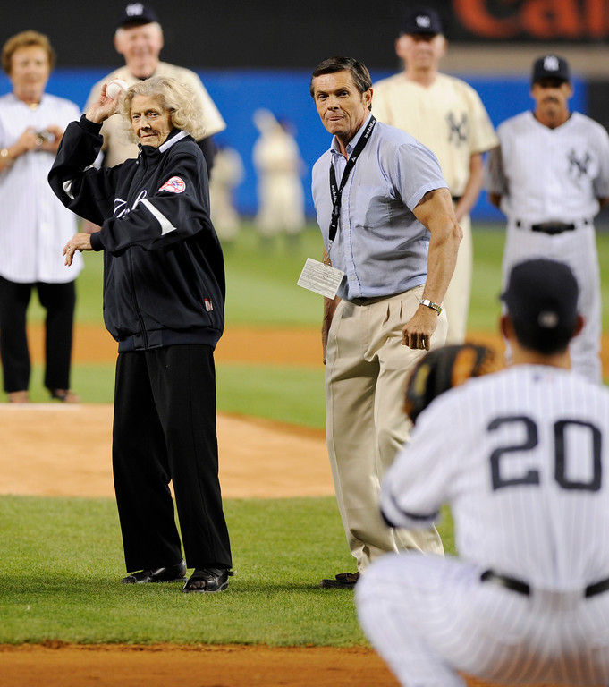 . Julia Ruth Stevens, the daughter of former New York Yankee Babe Ruth, throws a pitch to Yankees catcher Jorge Posada during ceremonies at Yankee Stadium in New York on Sunday, Sept. 21, 2008. The Yankees went on to play the Baltimore Orioles in what will likely be the last baseball game played at the stadium. (AP Photo/Ed Betz)