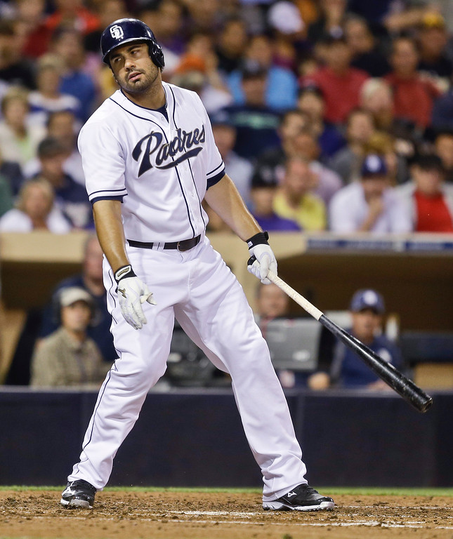 . San Diego Padres\' Carlos Quentin reacts to striking out against the Colorado Rockies in the fourth inning of a baseball game in San Diego, Wednesday, July 10, 2013. The Padres have been limited to one hit through five innings.  (AP Photo/Lenny Ignelzi)