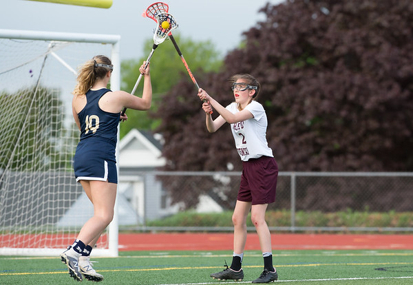 05/10/19 Wesley Bunnell | Staff Newington girls lacrosse defeated Bristol Central in an away game at Bristol Central High School on Friday afternoon. Newington's Maya Gajowiak (19) and Allison Jessie (2).