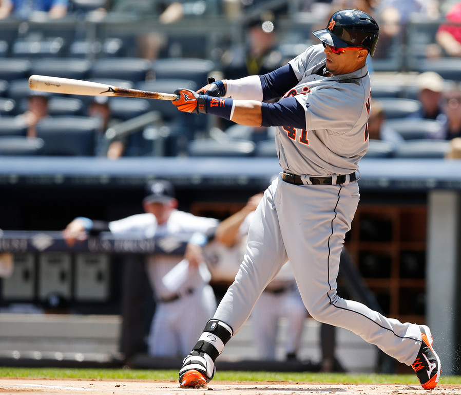 . Detroit Tigers designated hitter Victor Martinez (41) hits a first-inning, two-run home run off New York Yankees starting pitcher Masahiro Tanaka in a baseball game at Yankee Stadium in New York, Sunday, June 21, 2015. (AP Photo/Kathy Willens)