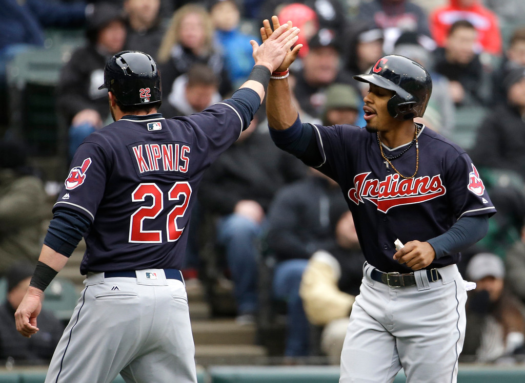 . Cleveland Indians\' Francisco Lindor, right, celebrates with Jason Kipnis after scoring on a fielder\'s choice by Carlos Santana during the first inning of a baseball game against the Chicago White Sox, Friday, April 8, 2016, in Chicago. (AP Photo/Nam Y. Huh)