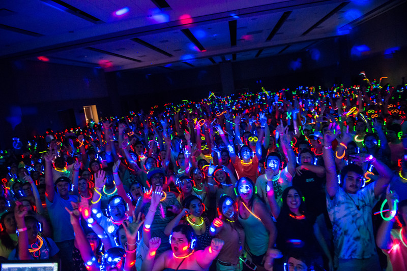 Attendees at the New Student Orientation Reunion Glow Party at the UC Anchor Ballroom.