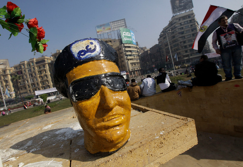 ". A figurine representing Egypt\'s Defense Minister Gen. Abdel-Fattah el-Sissi sits at the memorial in Tahrir Square, the epicenter of the 2011 uprising, in Cairo, Egypt, Saturday, Jan. 25, 2014. Demonstrators began gathering Saturday in Egypt\'s Tahrir Square to mark the third anniversary of the start of its 2011 revolution, following a spate of bombings claimed by militants. The Arabic on the statuette reads, ""Yes.\"" (AP Photo/Amr Nabil)"