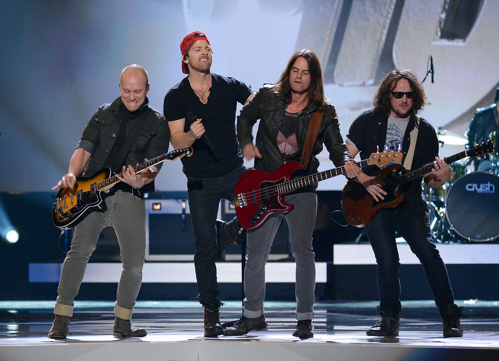. LAS VEGAS, NV - DECEMBER 10:  Singer Kip Moore (2nd L) performs with musicians onstage during the 2012 American Country Awards at the Mandalay Bay Events Center on December 10, 2012 in Las Vegas, Nevada.  (Photo by Mark Davis/Getty Images)