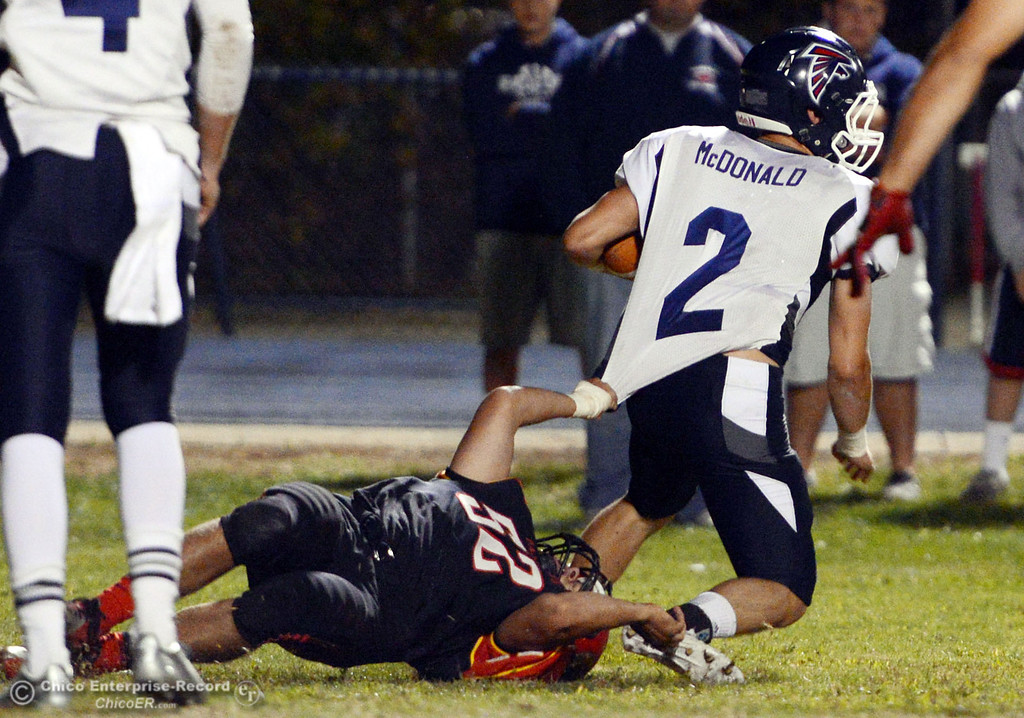 . Chico High\'s #52 Chad Farrell (left) tackles against Central Valley High\'s #2 Sawyer McDonald (right) in the first quarter of their football game at Asgard Yard Friday, September 27, 2013, in Chico, Calif.  (Jason Halley/Chico Enterprise-Record)