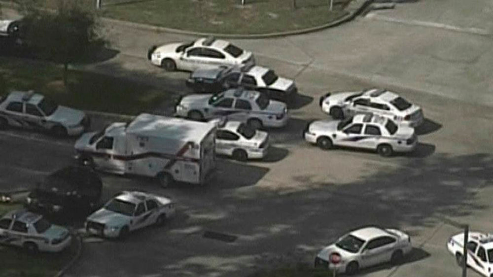 Description of . Police and emergency personnel vehicles line the road outside a building on the Lone Star College Campus near Houston, Texas in this still image taken from video courtesy of KPRC-TV Houston January 22, 2013.  Multiple people have been shot according to news reports.  REUTERS/KPRC-TV Houston/Handout