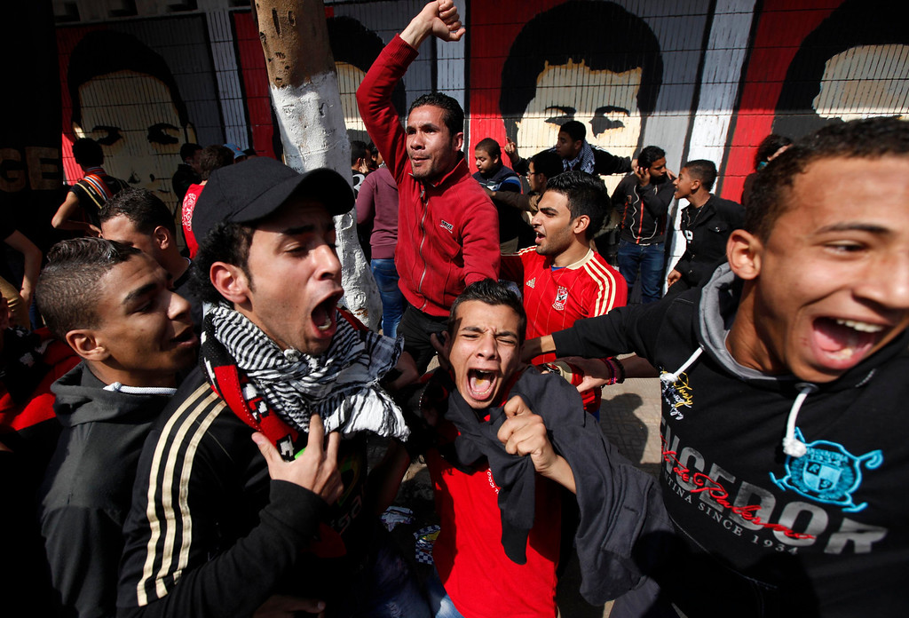 """. Al-Ahly fans, also known as \""""Ultras\"""", celebrate and shout slogans in front of Al-Ahly club after hearing the final verdict of the 2012 Port Said massacre in Cairo March 9, 2013.  REUTERS/Amr Abdallah Dalsh"""